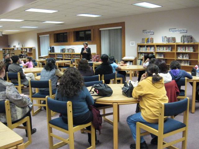 Juana Watson talks with Goshen Middle School parents